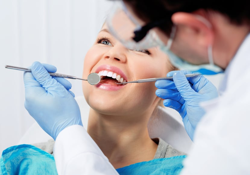Dental cure. Molar treatment. Young female patient at dentist